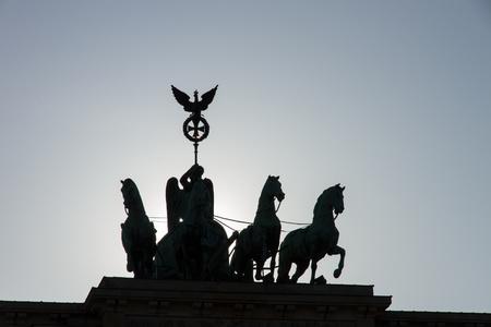 famous quadriga on Brandenburg Gate as a silhouette due to backlight Standard-Bild