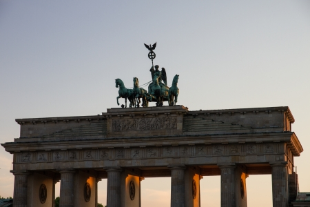 Upper part of Brandenburg Gate at sunset photo