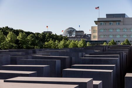 The memorial for the murdered Jews of Europe remembering of the Shoa in front the American Embassy and the Reichstag, seat of the German parliament Editorial