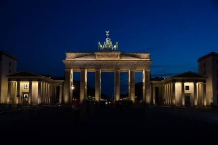 The famous landmark Brandeburg Gate in Berlin in the evening photo