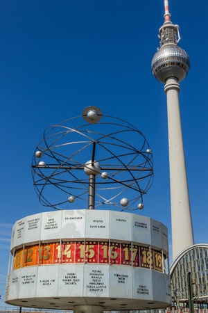 The famous world clock  Weltzeituhr  on Alexanderplatz square in Berlin with the tv tower  Fernsehturm  and the railway station in the background