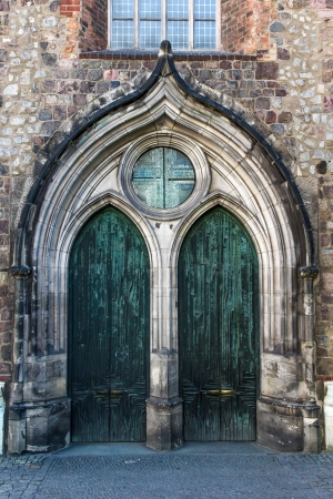 Gothic church gate with metal doors