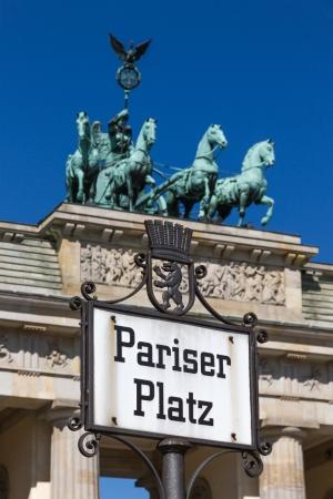 Sign on Paris Square  Pariser Platz  in Berlin with the Brandenburg Gate  Brandenburger Tor  in the background