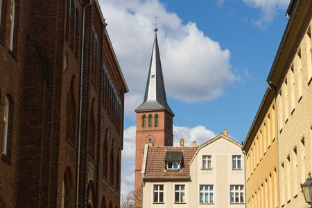 Historical buildings and the steeple of St  Lawrence Church  St  Laurentius  in the old town of Berlin-Koepenick