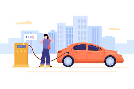 Young woman talking mobile phone and filling up fuel into car at gas station.