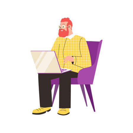 Bearded man in glasses sitting in armchair with laptop computer on laps.