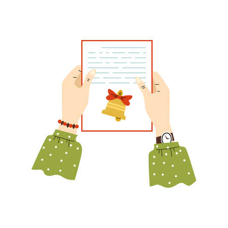 Female hands holding paper handwriting letter with greeting merry christmas.