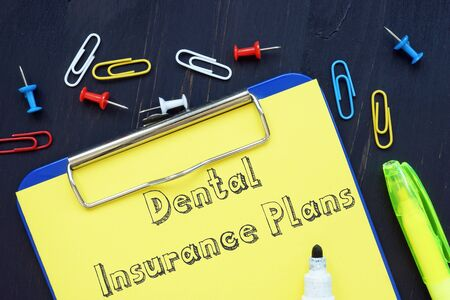 Conceptual hand writing showing Dental Insurance Plans.