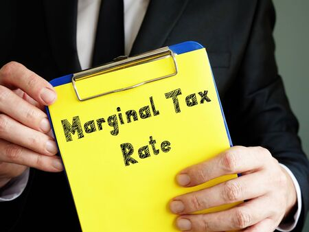 Marginal Tax Rate  sign on the sheet. Archivio Fotografico