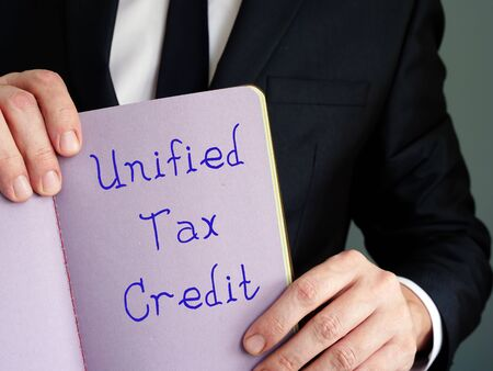 Financial concept meaning Unified Tax Credit with sign on the piece of paper.