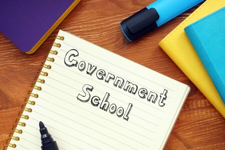 Educational concept about Government School with phrase on the piece of paper.