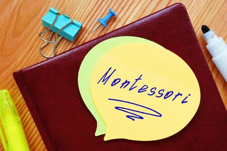 Business concept meaning Montessori with sign on the piece of paper.
