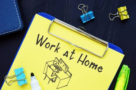 Business concept meaning Work at Home with phrase on the piece of paper. Stock Photo