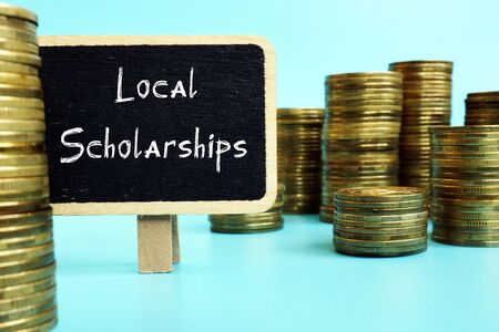 Educational concept meaning Local Scholarships with phrase on the sheet. Foto de archivo