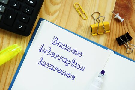 Financial concept meaning Business Interruption Insurance with sign on the piece of paper. Фото со стока