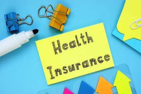 Financial concept about Health Insurance with inscription on the piece of paper.
