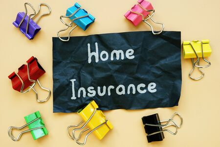 Financial concept meaning Home Insurance with sign on the page.
