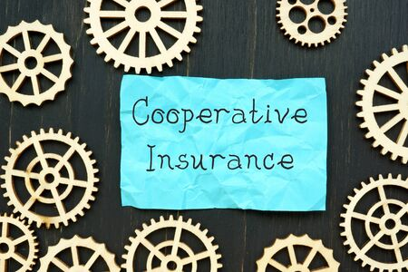 Financial concept about Cooperative Insurance with sign on the sheet. Фото со стока