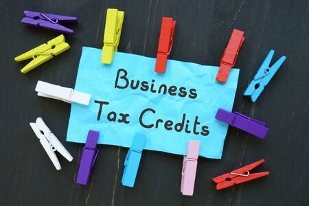 Financial concept about Business Tax Credits with sign on the sheet.