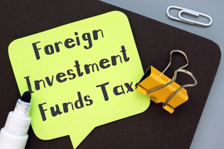 Financial concept meaning Foreign Investment Funds Tax with inscription on the sheet.