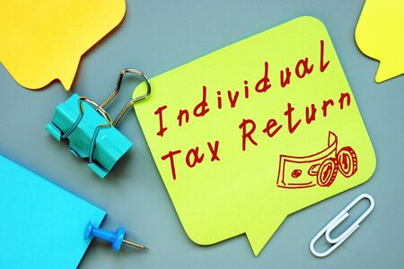 Business concept about Individual Tax Return with sign on the sheet. Imagens