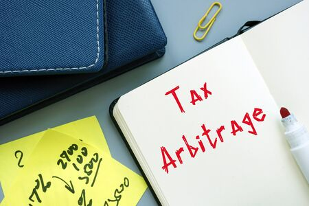 Business concept about Tax Arbitrage with sign on the page.