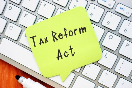 Financial concept meaning Tax Reform Act with phrase on the sheet.