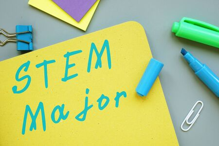 Educational concept about STEM Major with sign on the page.