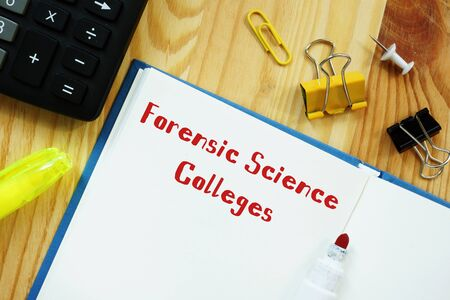 Educational concept about Forensic Science Colleges with sign on the sheet.