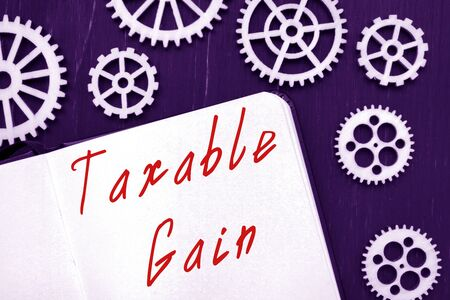 Financial concept about Taxable Gain with sign on the page.