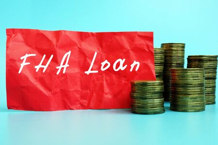 Financial concept meaning Federal Housing Administration FHA Loan with phrase on the sheet. Фото со стока