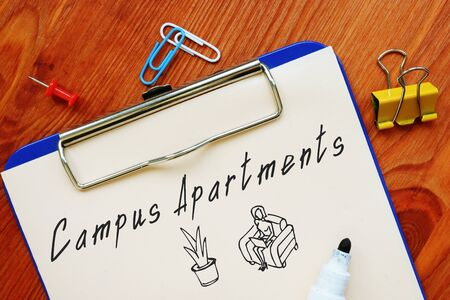 Business concept meaning Campus Apartments with inscription on the piece of paper.