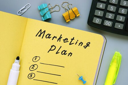 Financial concept meaning Marketing Plan with sign on the sheet.