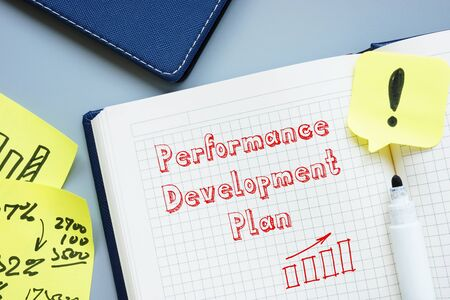Financial concept about Performance Development Plan with inscription on the page.