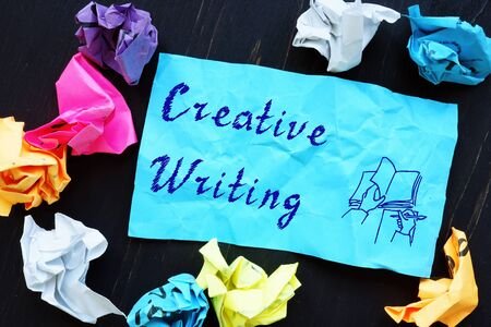 Business concept meaning Creative Writing with sign on the piece of paper.
