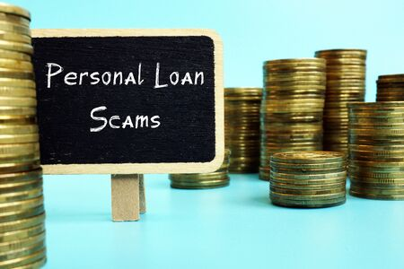 Business concept about Personal Loan Scams with phrase on the piece of paper.
