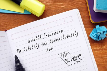 Business concept meaning Health Insurance Portability And Accountability Act with phrase on the piece of paper.