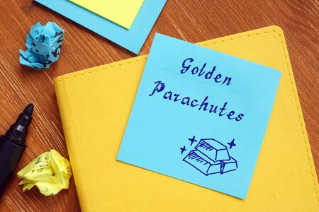 Business concept meaning Golden Parachutes - Executive Compensation Packages with sign on the sheet. Zdjęcie Seryjne