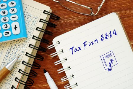 Financial concept meaning Tax Form 8814 with sign on the piece of paper.