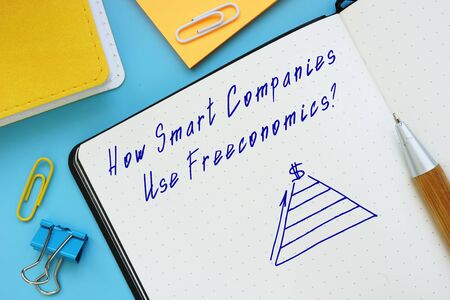 Business concept about How Smart Companies Use Freeconomics with inscription on the sheet. Zdjęcie Seryjne
