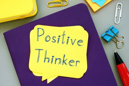 Business concept about Positive Thinker with inscription on the sheet.