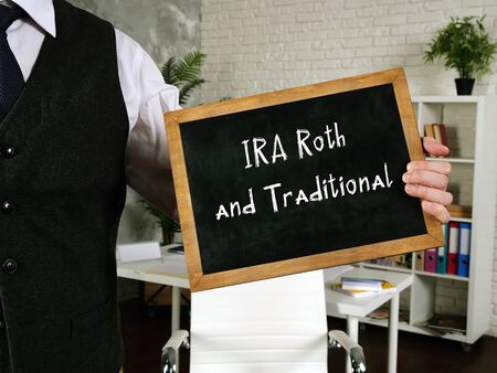 Financial concept meaning IRA Roth and Traditional with inscription on the page.