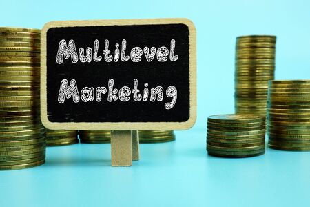 Business concept meaning Multilevel Marketing (MLM) with sign on the page.