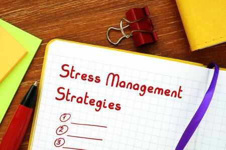 Motivation concept meaning Stress Management Strategies with sign on the sheet.
