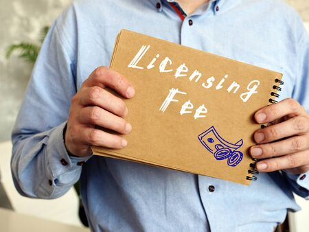Financial concept about Licensing Fee with sign on the page.