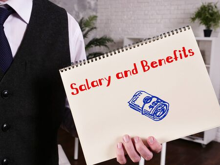 Conceptual photo about Salary and Benefits with handwritten phrase.