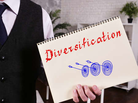 Financial concept meaning Diversification with inscription on the piece of paper.