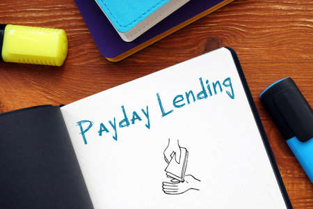 Business concept about Payday Lending with inscription on the sheet. Archivio Fotografico