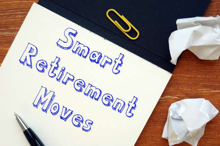 Financial concept meaning Smart Retirement Moves with sign on the sheet. Archivio Fotografico