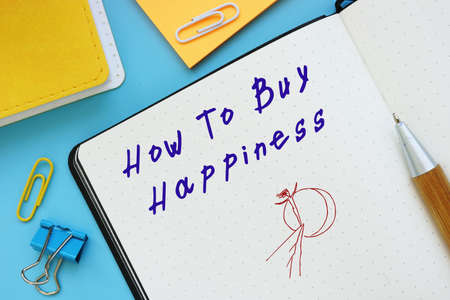Business concept about How To Buy Happiness with sign on the sheet.